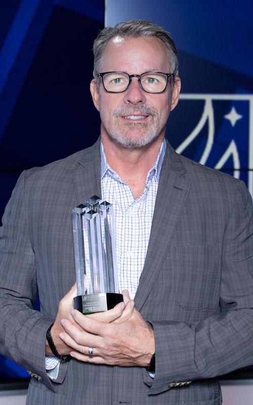 Glenn Granger holding his award